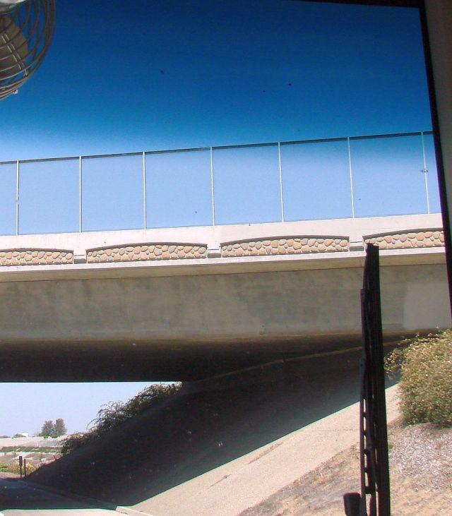 2014-4-6h can't fix broken roads, but can afford artwork on bridge