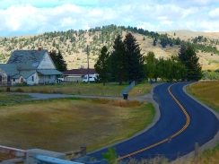 I thought I'd likely delete this photo that I shot in a hurry, but the geometry of the roadway and quaint home turned out pretty interesting.