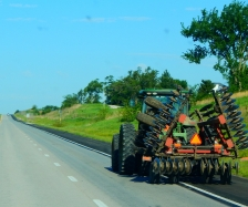 """Sharing the road Missouri farm country style. Electronic signs along the way read """"It's planting season - watch for farm vehicles."""""""