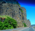 The tiny cars give some scale to the enormous cliffs.