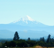 Mount McLoughlin as seen from I-5. From Wikipedia: Mt. McLoughlin is a steep-sided lava cone built on top of a composite volcano in the Cascade Range of southern Oregon and within the Sky Lakes Wilderness. It is one of the volcanic peaks in the Cascade Volcanic Arc. Elevation: 9,495 Ft.