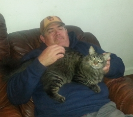 The Cat Whisperer. Dean loves cats and this is the other cat, Boy Cat, a part of the Gillespie Menagerie.