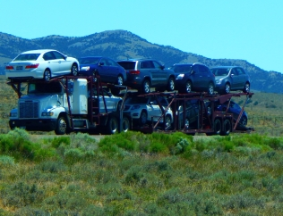"""Nine car """"portable parking lot"""". I've never seen more than nine average size cars on a truck. Are there bigger auto transporters?"""