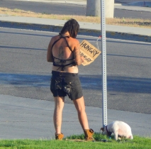 Dog tied to post, begging sign at the ready, and we saw one person give her money. Maybe they'd buy some soap??