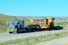 A huge, wide load heading east on I-80. This is the front end of a mining dump truck so huge that it must be transported in pieces and assembled on site.