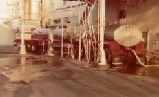 The old milk tanks I pulled with a Freightliner powered by a Detroit 318 with 4X4 transmissions. Here I'm unloading at the old, long ago closed Carnation canned milk plant in Gustine, Calif.