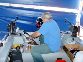 Here I install electric downriggers in place of the manuals that came with it.