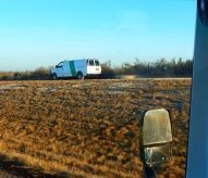 Here a Border Patrol van pulls big tires over the trail to keep it fresh to observe any signs of illegals.