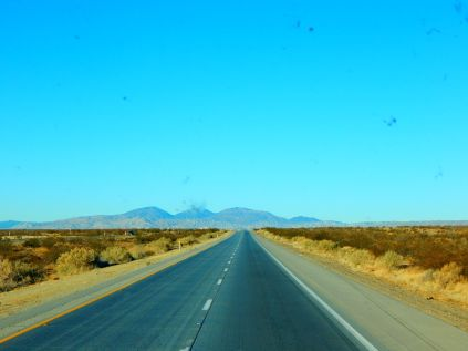 Driving through the Mojave Desert toward the distant Tehachapi Mountains.