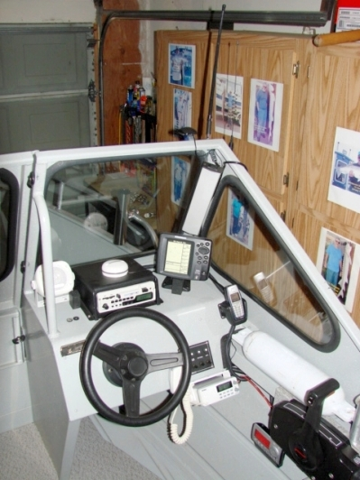 Here's the completed helm. Note AM/FM/tape radio, VHS, cell phone cradle, XM to far right. For a 15' boat it was loaded!