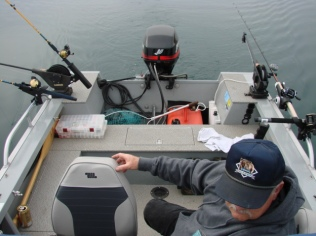 My friend John as we trolled Camanche lake. Note the manual downriggers which I replaced with electrics.
