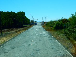 The truly rotten road west of Gridley taken one year ago...