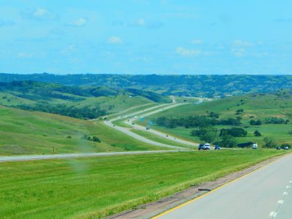 I-90 flows like a stream through the hills of South Dakota.