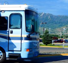 "As the coach sits on the Butte, MT Walmart lot, look near the front roof line of the coach and ""Our Lady of the Rockies"" is visible high on the Continental Divide overlooking the city of Butte."