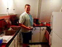 Craig in their little kitchen.