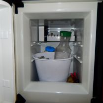 A freezer section with two containers for ice so some foods could be put directly on ice.