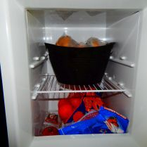 The other freezer section with ice above and fruit, etc. below.