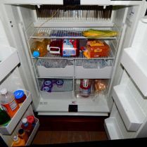 Note the large crisper boxes near the center with bags of ice to keep the fridge cool.