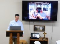 Kevin as M. C. as slides played on the screen. The photo shown is of Dean and I aboard my fishing boat.