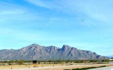 A relatively small desert mountain.