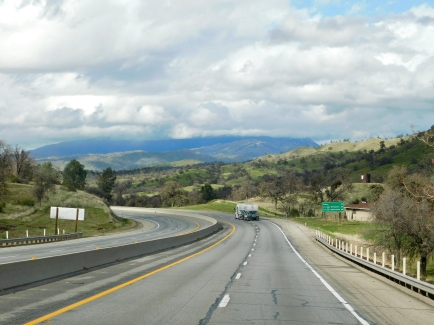 Driving through the green Tehachapi Mountains and dropping down toward Bakersfield.