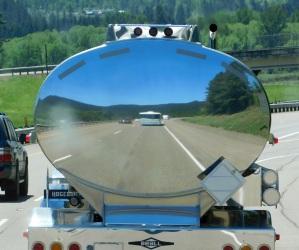 Big Blue's self portrait behind a polished tank trailer.