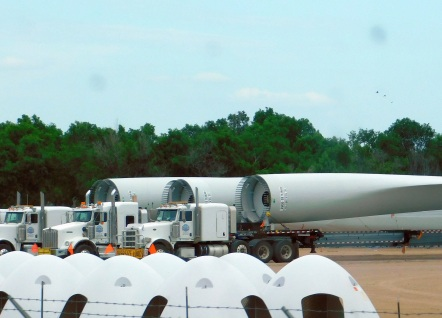 Here wind turbine blades sit on trucks ready to be shipped from Garden City, Kansas. It's pretty obvious here how huge those things are!