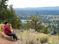 A musician enjoying the view from atop Pilot Butte. He sat and played the entire time we were there.