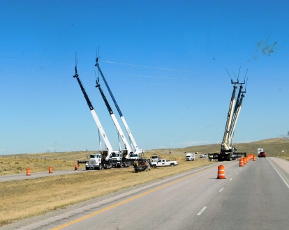 These huge boom trucks were simply helping to string power lines across I-80. It is obviously a very big job.