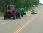 ...who's got the right of way? In Kansas I'd go with tractor!