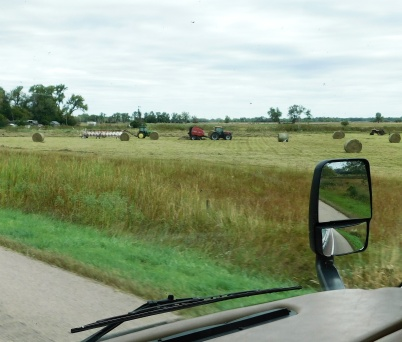 Baling hay the modern way - and no back breaking lifting and hauling it to the barn.
