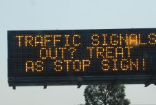Due to the terrible winds, power in some Kalifornistan counties would be turned off, and this highway sign explains what to do when signal lights are out.
