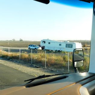 Sadly, this near-homeless situation is getting pretty common where we live. Folks buy an old RV and park it along some road 'til they're made to move. This was between our home and Stockton.