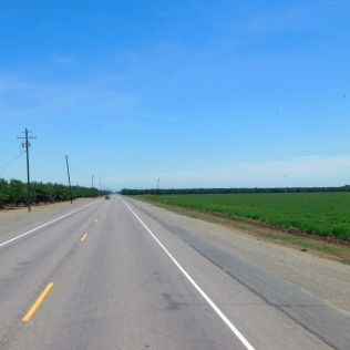 Highway 162 eastbound from I-5 to CA99. It is miles of farmland with little traffic.