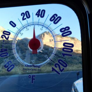 It was freezing at the rest area. Before we began this adventure, I placed a window mounted thermometer on both cockpit side windows. Finally, I can know the somewhat accurate outside temperature by reading the thermometer on the shady side of the coach.